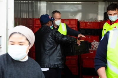 MELBOURNE, AUSTRALIA - JULY 10: Former Labor Leader Bill Shorten (background) is seen loading a freezer full of halal meat for the residents affected in the Alfred Street tower which is still under hard lockdown during COVID 19 on 10 July, 2020 in Melbourne, Australia. Former Federal Labor Leader Bill Shorten, along with close allies at Trades Hall help deliver Halal meat, supplied by Macca Halal Foods to the locked down housing commission towers following a COVID-19 outbreak detected inside the complex. Mr Shorten was able to use his high profile to ensure food was not turned away by police so that it would reach the residents inside. (Photo by Speed Media/Icon Sportswire)