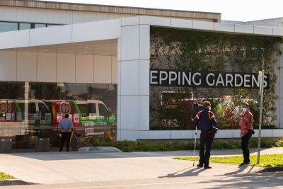 """MELBOURNE, AUSTRALIA - JULY 29: A view of the main entrance of Epping Gardens Aged Care Facility as authorities rush to evacuate residents by ambulance during COVID 19 on 29 July, 2020 in Melbourne, Australia. Staff at the Epping Gardens Aged Care facility, where there have been 83 COVID-19 cases and five deaths, have been stood down over an """"extremely dangerous breach"""". A memo was sent to relatives by management to advise that police had been called after it emerged that staff had held a get-together on the property. This comes as 295 new Coronavirus cases were discovered overnight, bringing the states total active cases to 4,775. (Photo by Speed Media/Icon Sportswire)"""