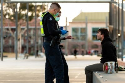 MELBOURNE, AUSTRALIA - JULY 29: Police officers arrest an abusive skateboarder who tried to run from the officers as they gave him a move on order for not wearing a facemask and disturbing the peace. The man was later released during COVID 19 on 29 July, 2020 in Melbourne, Australia. As sustained high numbers of new Coronavirus cases are being discovered, Metropolitan Melbourne and the Mitchell Shire remain under Stage 3 restrictions with facemasks being made mandatory on 23 July. 295 new cases were found overnight bringing the states total active case numbers to 4,775. (Photo by Speed Media/Icon Sportswire)