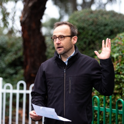 MELBOURNE, AUSTRALIA - JULY 5: The Federal Greens Leader Adam Bandt speaks to the media at the entrance of 12 Sutton Street North Melbourne after a failed attempt to drop multi lingual leaflets into the the mailboxes of residents in that tower to help them understand why they were forbidden to leave their units amid a full and total lockdown of 9 housing commission high rise towers in North Melbourne and Flemington during COVID 19 on 5 July, 2020 in Melbourne, Australia. After 108 new cases where uncovered overnight, the Premier Daniel Andrews announced on July 4 that effective at midnight last night, two more suburbs have been added to the suburb by suburb lockdown being Flemington and North Melbourne. Further to that, nine high rise public housing buildings in these suburbs have been placed under hard lockdown for a minimum of five days, effective immediately.  Residents in these towers will not be allowed to leave their units for any reason. Police will be stationed at every entry and exit point, every level, and they will also surround these locations preventing any movement in, or out. There is a total of 1354 units and over 3000 residents living in these buildings including the states most vulnerable people. Authorities will ensure that food, medical supplies and general supplies will be provided as well as any mental health services as required. This move is unprecedented in Australia's history and will require an unprecedented number of police to enforce the total lockdown with estimates of over 500 police officers stationed at these locations to enforce the lockdown orders. This comes amid fears of a second wave of Coronavirus infections in Victoria, with the total active cases now being 509. Fourteen are linked to controlled out breaks, 25 from routine testing and 69 are still under investigation. These new restrictions will remain in place for fourteen days with fears of further lockdowns to come. The Government have stressed that if Victorians do not fol