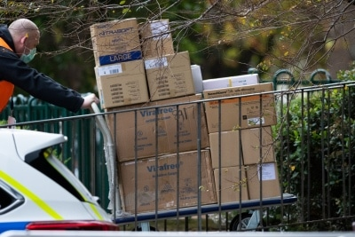 MELBOURNE, AUSTRALIA - JULY 5: Large numbers of boxes of Medical PPE are taken inside 120 Racecourse Road as government worker prepare to test 3000 affected residents amid a full and total lockdown of 9 housing commission high rise towers in North Melbourne and Flemington during COVID 19 on 5 July, 2020 in Melbourne, Australia. After 108 new cases where uncovered overnight, the Premier Daniel Andrews announced on July 4 that effective at midnight last night, two more suburbs have been added to the suburb by suburb lockdown being Flemington and North Melbourne. Further to that, nine high rise public housing buildings in these suburbs have been placed under hard lockdown for a minimum of five days, effective immediately.  Residents in these towers will not be allowed to leave their units for any reason. Police will be stationed at every entry and exit point, every level, and they will also surround these locations preventing any movement in, or out. There is a total of 1354 units and over 3000 residents living in these buildings including the states most vulnerable people. Authorities will ensure that food, medical supplies and general supplies will be provided as well as any mental health services as required. This move is unprecedented in Australia's history and will require an unprecedented number of police to enforce the total lockdown with estimates of over 500 police officers stationed at these locations to enforce the lockdown orders. This comes amid fears of a second wave of Coronavirus infections in Victoria, with the total active cases now being 509. Fourteen are linked to controlled out breaks, 25 from routine testing and 69 are still under investigation. These new restrictions will remain in place for fourteen days with fears of further lockdowns to come. The Government have stressed that if Victorians do not follow the basic COVIDSafe rules, the whole state will go back in to lockdown. (Photo by Speed Media/Icon Sportswire)