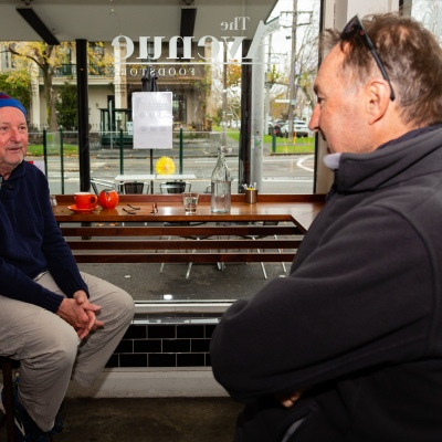 MELBOURNE, AUSTRALIA - June 01: Two men are seen enjoying a coffee inside The Avenue Food Store in Middle Park as bars, cafes and restaurants reopen their doors for up to 20 patrons at a time on 01 June, 2020 in Melbourne, Australia. Victoria is open for business as cafes, bars and restaurants once again open their doors for a maximum of 20 sit down patrons from today. The Victorian Premier Daniel Andrews, announced on the 16th May that all cafes, restaurants and bars will  be able to reopen for up to 20 patrons per enclosed space from the 1st of June and then a further easing of restrictions to 50 patrons on the 22nd of June. It comes as welcome news to the hospitality industry as it reels under the COVID-19 restrictions imposed on it for the past 3 months. Many will never trade again, and many are unable to open with so few patrons allowed and plan to wait for the next lifting of restrictions allowing 50 customers at any one time. (Photo by Speed Media/Icon Sportswire)