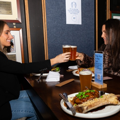 MELBOURNE, AUSTRALIA - June 01: Locals Taryn and Piper enjoy a beer and a meal at the Middle Park Hotel in Middle Park as COVID-19 restrictions ease today allowing up to 20 patrons in at bars, cafes and restaurants on 01 June, 2020 in Melbourne, Australia. Victoria is open for business as cafes, bars and restaurants once again open their doors for a maximum of 20 sit down patrons from today. The Victorian Premier Daniel Andrews, announced on the 16th May that all cafes, restaurants and bars will  be able to reopen for up to 20 patrons per enclosed space from the 1st of June and then a further easing of restrictions to 50 patrons on the 22nd of June. It comes as welcome news to the hospitality industry as it reels under the COVID-19 restrictions imposed on it for the past 3 months. Many will never trade again, and many are unable to open with so few patrons allowed and plan to wait for the next lifting of restrictions allowing 50 customers at any one time. (Photo by Speed Media/Icon Sportswire)