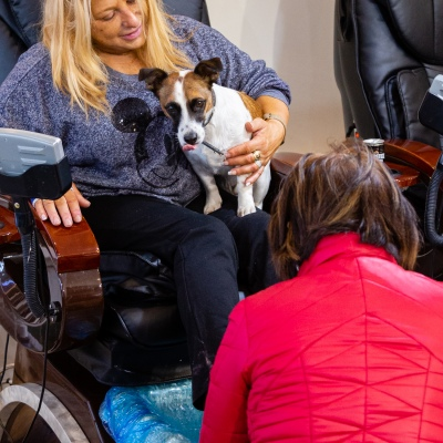 MELBOURNE, AUSTRALIA - June 01: A local and her dog are seen getting a pedicure at The One Nails nail salon in Acland Street as they reopen today after being forced to close for three months due to COVID-19 on 01 June, 2020 in Melbourne, Australia. Victoria is open for business as beauty salons, cafes, bars and restaurants along with museums and zoo's once again open their doors for a maximum of 20 sit down patrons from today. The Victorian Premier Daniel Andrews, announced on the 16th May that all cafes, restaurants and bars will  be able to reopen for up to 20 patrons per enclosed space from the 1st of June and then a further easing of restrictions to 50 patrons on the 22nd of June. It comes as welcome news to the hospitality industry as it reels under the COVID-19 restrictions imposed on it for the past 3 months. Many will never trade again, and many are unable to open with so few patrons allowed and plan to wait for the next lifting of restrictions allowing 50 customers at any one time. (Photo by Speed Media/Icon Sportswire)