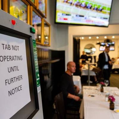 MELBOURNE, AUSTRALIA - June 01:  A sign advising customers that TAB will not be operating for the foreseeable future is seen in the Emerald Hotel as patrons are finally allowed back in for a drink on 01 June, 2020 in Melbourne, Australia. Victoria is open for business as cafes, bars and restaurants once again open their doors for a maximum of 20 sit down patrons from today. The Victorian Premier Daniel Andrews, announced on the 16th May that all cafes, restaurants and bars will  be able to reopen for up to 20 patrons per enclosed space from the 1st of June and then a further easing of restrictions to 50 patrons on the 22nd of June. It comes as welcome news to the hospitality industry as it reels under the COVID-19 restrictions imposed on it for the past 3 months. Many will never trade again, and many are unable to open with so few patrons allowed and plan to wait for the next lifting of restrictions allowing 50 customers at any one time. (Photo by Speed Media/Icon Sportswire)