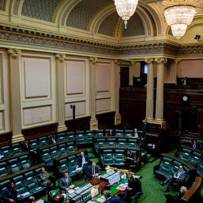 """MELBOURNE, AUSTRALIA - June 02: Seats in the Legislative Assembly are marked with """"Do Not Sit' signs as normal sitting resumes at the Victorian Parliament with a reduced number of MPs due to COVID-19 restrictions on 02 June, 2020 in Melbourne, Australia. After adjourning due to COVID-19, Victoria's parliament has returned to scheduled sittings from today albeit with COVIDSafe restrictions still in place along with a reduced number of MP's sitting.  It was announced on the 20th May that both houses will sit from June 2 to 4 and 16 to 18. It comes amid heavy criticism aimed at the Andrews led government over the deal with China's Belt and Road Initiative. (Photo by Speed Media/Icon Sportswire)"""