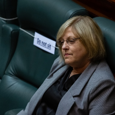 MELBOURNE, AUSTRALIA - June 02: Minister for Police and Emergency Services, Lisa Neville is seen surrounded by empty chairs as parliament sits with reduced capacity due to COVID-19 social distancing on 02 June, 2020 in Melbourne, Australia. After adjourning due to COVID-19, Victoria's parliament has returned to scheduled sittings from today albeit with COVIDSafe restrictions still in place along with a reduced number of MP's sitting.  It was announced on the 20th May that both houses will sit from June 2 to 4 and 16 to 18. It comes amid heavy criticism aimed at the Andrews led government over the deal with China's Belt and Road Initiative. (Photo by Speed Media/Icon Sportswire)