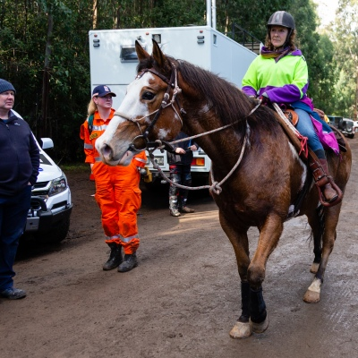 Local volunteers on horse back return to the staging area at Mt Disappointment in Victoria. An air-and-ground search is continuing for lost Victorian teenager William Callaghan, who suffers from non-verbal autism and is lost in steep and rugged terrain in Victoria after temperatures dropped below freezing overnight.