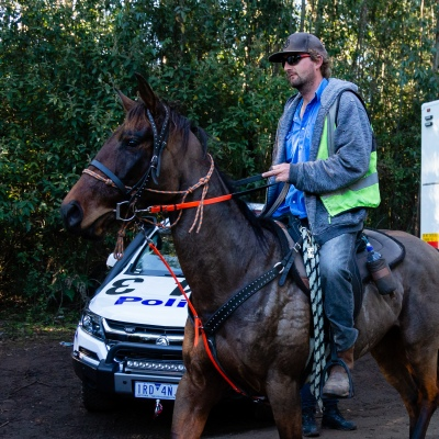 Locals on horse back arrive back at the staging area after William was found at Mt Disappointment in Victoria. An air-and-ground search is continuing for lost Victorian teenager William Callaghan, who suffers from non-verbal autism and is lost in steep and rugged terrain in Victoria after temperatures dropped below freezing overnight.