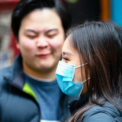 MELBOURNE, AUSTRALIA - June 21: A woman wearing a facemask is seen in the CBD as restrictions are being tightened in Victoria during COVID 19 on 21 June, 2020 in Melbourne, Australia. After a concerning spike in new coronavirus infections in metropolitan Melbourne which is once again sparking fears of a second wave, the Premier Daniel Andrews announced yesterday (20 June) that restrictions on the number of visitors in private homes will be reduced to ten to five. Victoria recorded 19 new cases overnight, the fifth day in a row of double digits increases, prompting the Government to extend the State of Emergency for another four weeks giving Police unprecedented powers to enforce directions managed by the State Government. It includes three new cases linked to an outbreak among contractors working at the Samford Plaza Hotel. The State was in the midst of easing restrictions allowing restaurants, bars and cafes to increase the number of inside patrons from 20 to 50. As a result of this spike, the Government has reversed in decision to further ease restrictions on hospitality businesses forcing many to shut their doors forever. Some of Melbourne's most well-known restaurateurs are at on the brink of permanent closure. Victoria has had the strictest Coronavirus restrictions in the country, yet is by far the worst performing state, raising questions over the real effectiveness of this strategy. (Photo by Speed Media/Icon Sportswire)