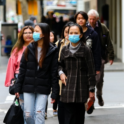 MELBOURNE, AUSTRALIA - June 21: Two women are seen wearing facemasks in the CBD as restrictions are being tightened in Victoria during COVID 19 on 21 June, 2020 in Melbourne, Australia. After a concerning spike in new coronavirus infections in metropolitan Melbourne which is once again sparking fears of a second wave, the Premier Daniel Andrews announced yesterday (20 June) that restrictions on the number of visitors in private homes will be reduced to ten to five. Victoria recorded 19 new cases overnight, the fifth day in a row of double digits increases, prompting the Government to extend the State of Emergency for another four weeks giving Police unprecedented powers to enforce directions managed by the State Government. It includes three new cases linked to an outbreak among contractors working at the Samford Plaza Hotel. The State was in the midst of easing restrictions allowing restaurants, bars and cafes to increase the number of inside patrons from 20 to 50. As a result of this spike, the Government has reversed in decision to further ease restrictions on hospitality businesses forcing many to shut their doors forever. Some of Melbourne's most well-known restaurateurs are at on the brink of permanent closure. Victoria has had the strictest Coronavirus restrictions in the country, yet is by far the worst performing state, raising questions over the real effectiveness of this strategy. (Photo by Speed Media/Icon Sportswire)