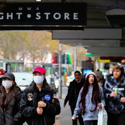MELBOURNE, AUSTRALIA - June 21: Despite fears of a Coronavirus second wave as new infections spike across Melbourne, people are flocking back into the CBD. Two women are seen walking along Elisabeth Street wearing facemasks as restrictions are being tightened in Victoria during COVID 19 on 21 June, 2020 in Melbourne, Australia. After a concerning spike in new coronavirus infections in metropolitan Melbourne which is once again sparking fears of a second wave, the Premier Daniel Andrews announced yesterday (20 June) that restrictions on the number of visitors in private homes will be reduced to ten to five. Victoria recorded 19 new cases overnight, the fifth day in a row of double digits increases, prompting the Government to extend the State of Emergency for another four weeks giving Police unprecedented powers to enforce directions managed by the State Government. It includes three new cases linked to an outbreak among contractors working at the Samford Plaza Hotel. The State was in the midst of easing restrictions allowing restaurants, bars and cafes to increase the number of inside patrons from 20 to 50. As a result of this spike, the Government has reversed in decision to further ease restrictions on hospitality businesses forcing many to shut their doors forever. Some of Melbourne's most well-known restaurateurs are at on the brink of permanent closure. Victoria has had the strictest Coronavirus restrictions in the country, yet is by far the worst performing state, raising questions over the real effectiveness of this strategy. (Photo by Speed Media/Icon Sportswire)