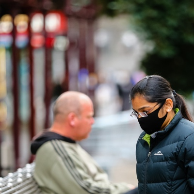 MELBOURNE, AUSTRALIA - June 21: A women is seen wearing a face mask on Bourke Street as restrictions are being tightened in Victoria during COVID 19 on 21 June, 2020 in Melbourne, Australia. After a concerning spike in new coronavirus infections in metropolitan Melbourne which is once again sparking fears of a second wave, the Premier Daniel Andrews announced yesterday (20 June) that restrictions on the number of visitors in private homes will be reduced to ten to five. Victoria recorded 19 new cases overnight, the fifth day in a row of double digits increases, prompting the Government to extend the State of Emergency for another four weeks giving Police unprecedented powers to enforce directions managed by the State Government. It includes three new cases linked to an outbreak among contractors working at the Samford Plaza Hotel. The State was in the midst of easing restrictions allowing restaurants, bars and cafes to increase the number of inside patrons from 20 to 50. As a result of this spike, the Government has reversed in decision to further ease restrictions on hospitality businesses forcing many to shut their doors forever. Some of Melbourne's most well-known restaurateurs are at on the brink of permanent closure. Victoria has had the strictest Coronavirus restrictions in the country, yet is by far the worst performing state, raising questions over the real effectiveness of this strategy. (Photo by Speed Media/Icon Sportswire)