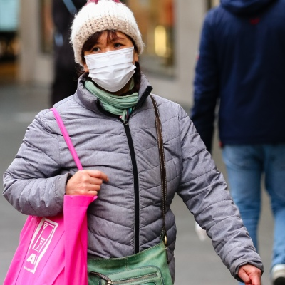 MELBOURNE, AUSTRALIA - June 21: A woman is seen wearing a facemask in Bourke Street as restrictions are being tightened in Victoria during COVID 19 on 21 June, 2020 in Melbourne, Australia. After a concerning spike in new coronavirus infections in metropolitan Melbourne which is once again sparking fears of a second wave, the Premier Daniel Andrews announced yesterday (20 June) that restrictions on the number of visitors in private homes will be reduced to ten to five. Victoria recorded 19 new cases overnight, the fifth day in a row of double digits increases, prompting the Government to extend the State of Emergency for another four weeks giving Police unprecedented powers to enforce directions managed by the State Government. It includes three new cases linked to an outbreak among contractors working at the Samford Plaza Hotel. The State was in the midst of easing restrictions allowing restaurants, bars and cafes to increase the number of inside patrons from 20 to 50. As a result of this spike, the Government has reversed in decision to further ease restrictions on hospitality businesses forcing many to shut their doors forever. Some of Melbourne's most well-known restaurateurs are at on the brink of permanent closure. Victoria has had the strictest Coronavirus restrictions in the country, yet is by far the worst performing state, raising questions over the real effectiveness of this strategy. (Photo by Speed Media/Icon Sportswire)