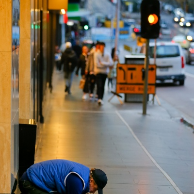 MELBOURNE, AUSTRALIA - June 21: A homeless man is seen begging on the street in the CBD as restrictions are being tightened in Victoria during COVID 19 on 21 June, 2020 in Melbourne, Australia. After a concerning spike in new coronavirus infections in metropolitan Melbourne which is once again sparking fears of a second wave, the Premier Daniel Andrews announced yesterday (20 June) that restrictions on the number of visitors in private homes will be reduced to ten to five. Victoria recorded 19 new cases overnight, the fifth day in a row of double digits increases, prompting the Government to extend the State of Emergency for another four weeks giving Police unprecedented powers to enforce directions managed by the State Government. It includes three new cases linked to an outbreak among contractors working at the Samford Plaza Hotel. The State was in the midst of easing restrictions allowing restaurants, bars and cafes to increase the number of inside patrons from 20 to 50. As a result of this spike, the Government has reversed in decision to further ease restrictions on hospitality businesses forcing many to shut their doors forever. Some of Melbourne's most well-known restaurateurs are at on the brink of permanent closure. Victoria has had the strictest Coronavirus restrictions in the country, yet is by far the worst performing state, raising questions over the real effectiveness of this strategy. (Photo by Speed Media/Icon Sportswire)