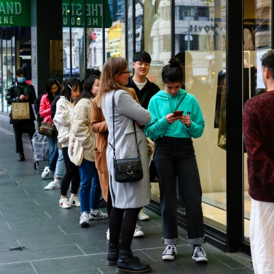 MELBOURNE, AUSTRALIA - June 21: Customers line up outside of the women's clothing retailer COS in Elizabeth Street in the CBD as they enforce strict social distancing rules within their store as restrictions are being tightened in Victoria during COVID 19 on 21 June, 2020 in Melbourne, Australia. After a concerning spike in new coronavirus infections in metropolitan Melbourne which is once again sparking fears of a second wave, the Premier Daniel Andrews announced yesterday (20 June) that restrictions on the number of visitors in private homes will be reduced to ten to five. Victoria recorded 19 new cases overnight, the fifth day in a row of double digits increases, prompting the Government to extend the State of Emergency for another four weeks giving Police unprecedented powers to enforce directions managed by the State Government. It includes three new cases linked to an outbreak among contractors working at the Samford Plaza Hotel. The State was in the midst of easing restrictions allowing restaurants, bars and cafes to increase the number of inside patrons from 20 to 50. As a result of this spike, the Government has reversed in decision to further ease restrictions on hospitality businesses forcing many to shut their doors forever. Some of Melbourne's most well-known restaurateurs are at on the brink of permanent closure. Victoria has had the strictest Coronavirus restrictions in the country, yet is by far the worst performing state, raising questions over the real effectiveness of this strategy. (Photo by Speed Media/Icon Sportswire)