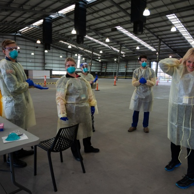 MELBOURNE, AUSTRALIA - June 27: Civilian and Military medics change PPE in the new Melbourne Showgrounds Mobile Testing Site  during COVID 19 on 27 June, 2020 in Melbourne, Australia. Amid a worrying increase of Coronavirus test positive cases in Victoria which is sparking fears of a second wave the State Premier, Daniel Andrews announced last week that a targeted testing blitz would be launched yesterday (26 June) across ten targeted suburbs to zero in on community transmission. For the next fortnight, 10,000 tests will be conducted across Keilor Downs, Broadmeadows, Maidstone, Albanvale, Sunshine West, Hallam, Brunswick West, Fawkner, Reservoir and Pakenham, with Keilor Downs and Broadmeadows identified as the top two and focus of the next three days of testing. An additional 41 new test positive cases have been uncovered overnight. (Photo by Speed Media/Icon Sportswire)