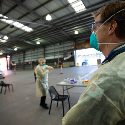 MELBOURNE, AUSTRALIA - June 27: An Australian Airforce Doctor assists at the Melbourne Showgrounds Mobile Testing Site during COVID 19 on 27 June, 2020 in Melbourne, Australia. Amid a worrying increase of Coronavirus test positive cases in Victoria which is sparking fears of a second wave the State Premier, Daniel Andrews announced last week that a targeted testing blitz would be launched yesterday (26 June) across ten targeted suburbs to zero in on community transmission. For the next fortnight, 10,000 tests will be conducted across Keilor Downs, Broadmeadows, Maidstone, Albanvale, Sunshine West, Hallam, Brunswick West, Fawkner, Reservoir and Pakenham, with Keilor Downs and Broadmeadows identified as the top two and focus of the next three days of testing. An additional 41 new test positive cases have been uncovered overnight. (Photo by Speed Media/Icon Sportswire)