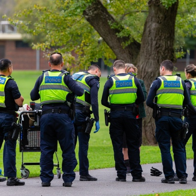 MELBOURNE, AUSTRALIA - MAY 03: Eight police officers, seemingly ignoring social distancing, question a homeless woman for sitting on a park bench during COVID 19 on 3 May, 2020 in Melbourne, Australia. (Photo by Speed Media/Icon Sportswire)