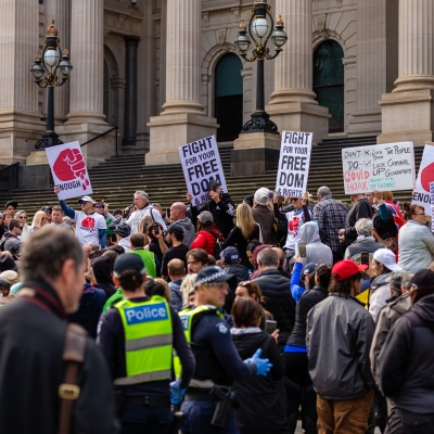 MELBOURNE, AUSTRALIA - MAY 10: Protesters hold up signs and placards during COVID 19 Anti Lockdown protest at Parliament House on 10 May, 2020 in Melbourne, Australia. (Photo by Speed Media/Icon Sportswire)