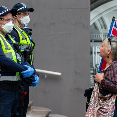 MELBOURNE, AUSTRALIA - MAY 10: A protester argues with police during COVID 19 Anti Lockdown protest at Parliament House on 10 May, 2020 in Melbourne, Australia. (Photo by Speed Media/Icon Sportswire)