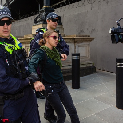 MELBOURNE, AUSTRALIA - MAY 10: Police arrest a female protester during COVID 19 Anti Lockdown protest at Parliament House on 10 May, 2020 in Melbourne, Australia. (Photo by Speed Media/Icon Sportswire)