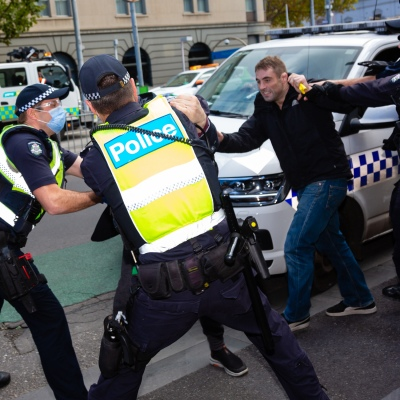 MELBOURNE, AUSTRALIA - MAY 10: Protesters scuffle with police during COVID 19 Anti Lockdown protest at Parliament House on 10 May, 2020 in Melbourne, Australia. (Photo by Speed Media/Icon Sportswire)