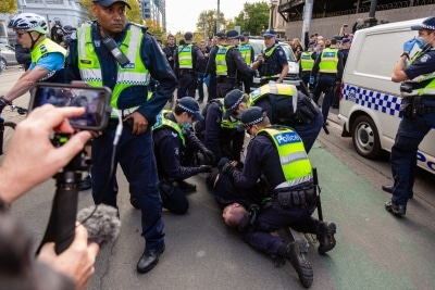 MELBOURNE, AUSTRALIA - MAY 10: Police arrest a protester during COVID 19 Anti Lockdown protest at Parliament House on 10 May, 2020 in Melbourne, Australia. (Photo by Speed Media/Icon Sportswire)
