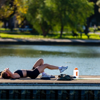 MELBOURNE, AUSTRALIA - MAY 16: A woman exercises on the pier at Albert Park Lake as restrictions are being eased in Victoria during COVID 19 on 16 May, 2020 in Melbourne, Australia. (Photo by Speed Media/Icon Sportswire)