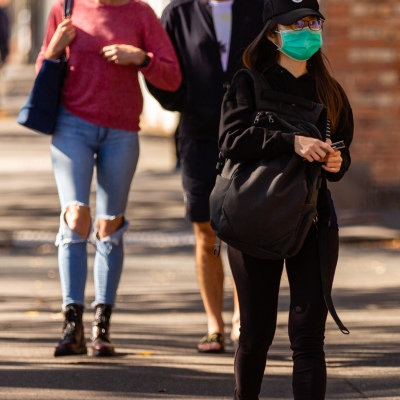 MELBOURNE, AUSTRALIA - MAY 17: A woman wearing a facemask is seen walking near South Melbourne Market as restrictions are being eased in Victoria during COVID 19 on 17 May, 2020 in Melbourne, Australia. (Photo by Speed Media/Icon Sportswire)