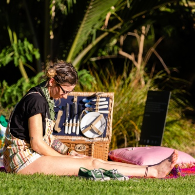 MELBOURNE, AUSTRALIA - MAY 17: Melbournians flock to the newly reopened Botanical Gardens as a woman is seen with her vintage picnic basket enjoying the sun as restrictions are being eased in Victoria during COVID 19 on 17 May, 2020 in Melbourne, Australia. (Photo by Speed Media/Icon Sportswire)