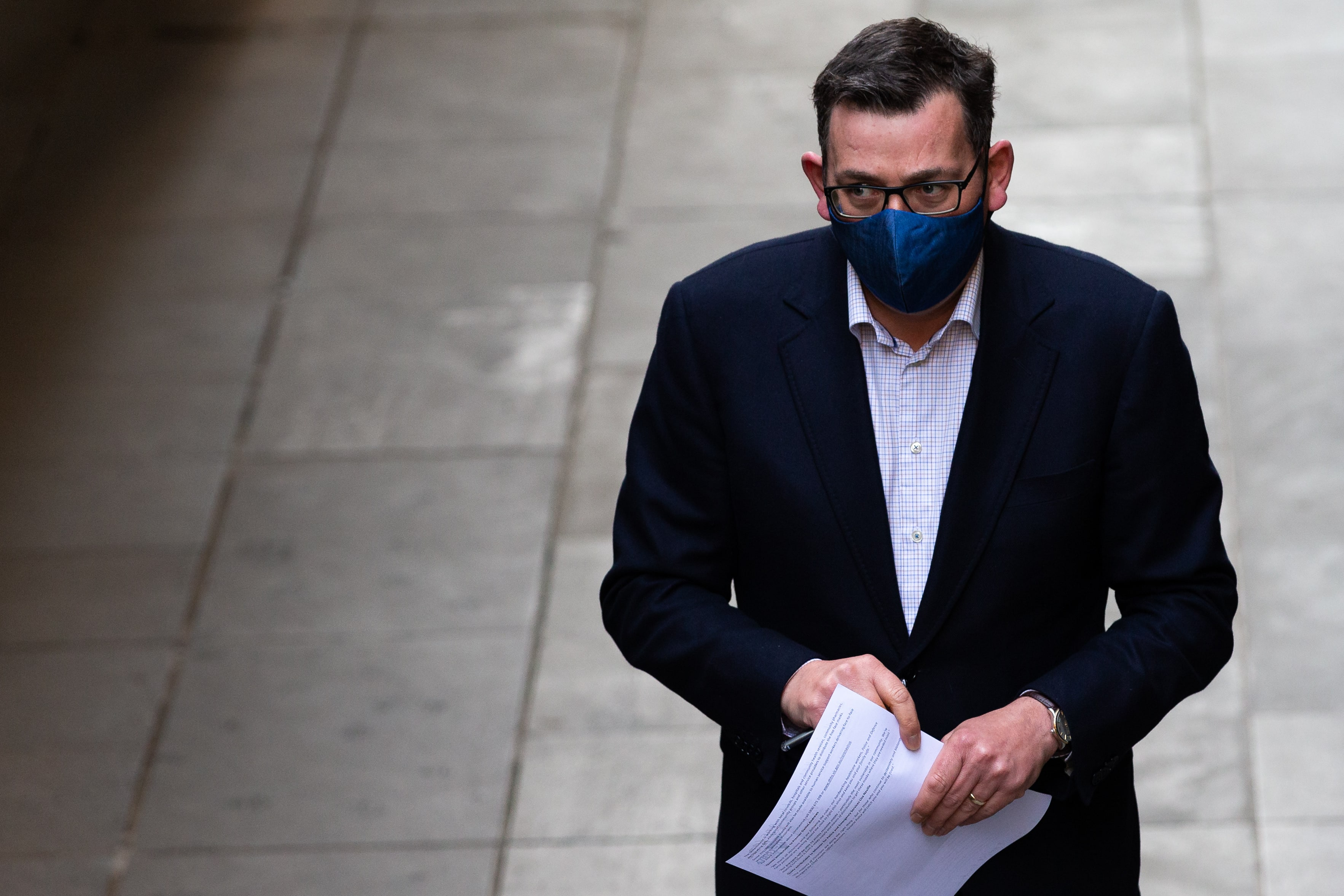 Premier Daniel Andrews wears a facemask as he arrives to updates the media during the daily COVID-19 press conference. A further 300 Coronavirus cases have been discovered overnight, and a further 6 deaths bringing Victoria's active cases to over 3600.