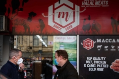 MELBOURNE, AUSTRALIA - JULY 10: Bill Shorten (Left) is seen discussing logistics with Trades Hall Council Secretary, Luke Hilakari (right) outside of Macca Halal Foods in Flemington before helping deliver halal meat to the residents in the locked down housing commission towers during COVID 19 on 10 July, 2020 in Melbourne, Australia. Former Federal Labor Leader Bill Shorten, along with close allies at Trades Hall help deliver Halal meat, supplied by Macca Halal Foods to the locked down housing commission towers following a COVID-19 outbreak detected inside the complex. Mr Shorten was able to use his high profile to ensure food was not turned away by police so that it would reach the residents inside. (Photo by Speed Media/Icon Sportswire)