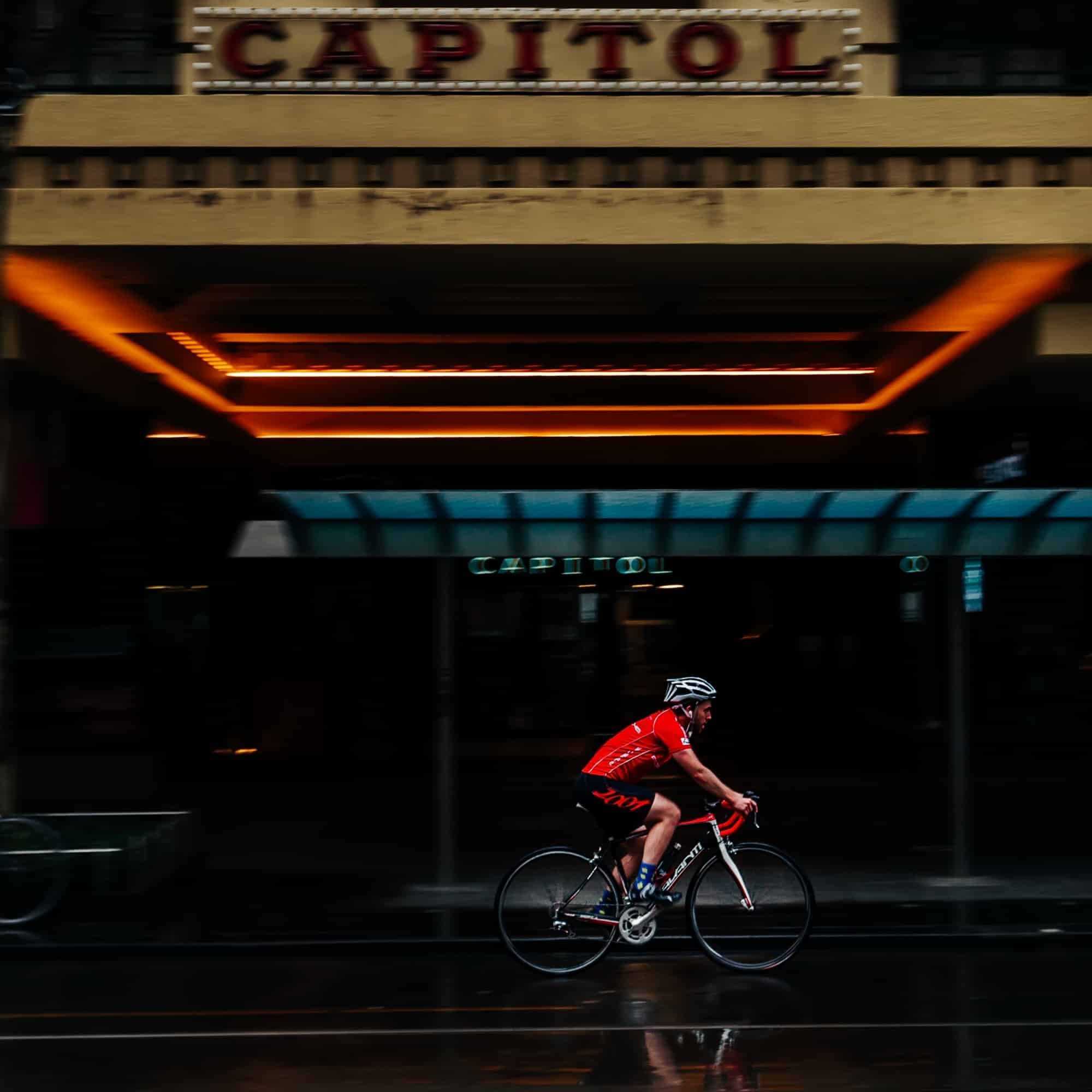 A bicyclist is seen braving the rain in Swanston Street during COVID-19 in Melbourne, Australia. Victoria has recorded 14 COVID related deaths including a 20 year old, marking the youngest to die from Coronavirus in Australia, and an additional 372 new cases overnight.