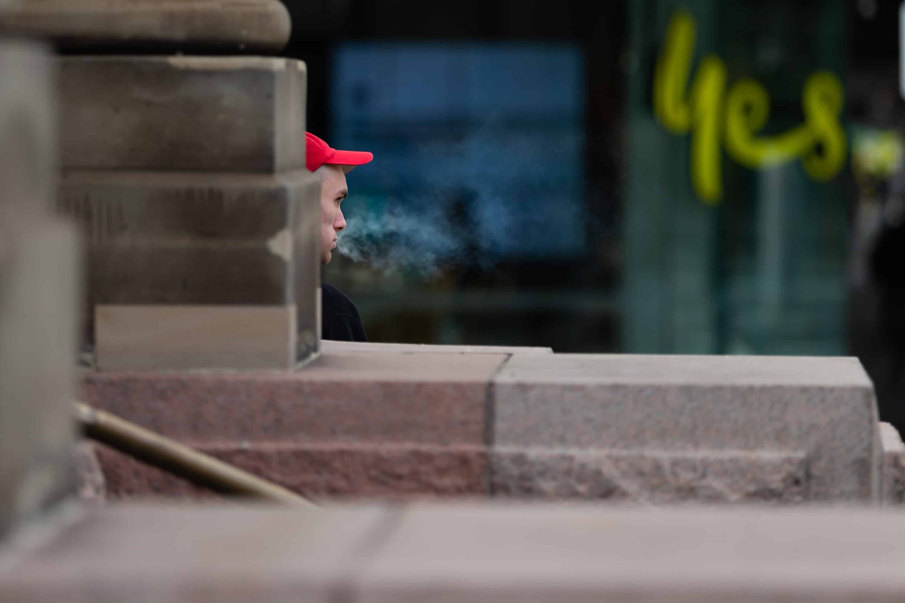 A man is seen smoking in the Bourke Street Mall during COVID-19 in Melbourne, Australia. Victoria records a further 76 cases of Coronavirus over the past 24 hours, an increase from yesterday along with 11 deaths. This comes amid news that AstraZeneca pauses vaccine study.