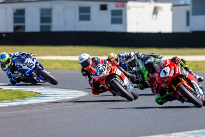 Troy Herfoss (1) riding for Penrite Honda Racing & Mike Jones (46) riding for Desmosport Ducati in race 2 during round 6 of the Australian Superbike Championship on October 06, 2019 at Phillip Island Circuit, Victoria. (Image Dave Hewison/ Speed Media)