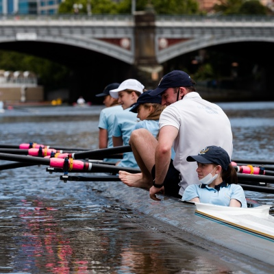 A young girl is seen in the coxswains seat as her four maneuvers into the boat ramps in the Yarra during the COVID-19 in Melbourne. With over a week of zero cases in Victoria, Premier Daniel Andrews is expected to make major announcements on Sunday about further easing of restrictions.